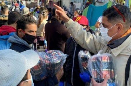 Seeking to return home, Venezuelan & Peruvian migrants camp outside embassies in Chile