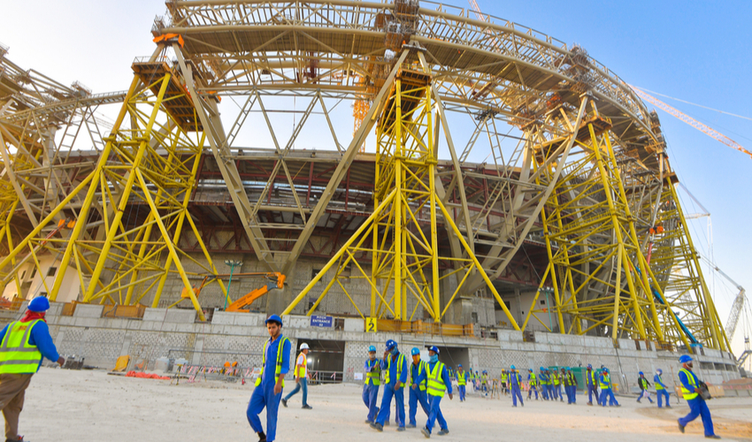 Workers walk towards the construction site of the Lusail Stadium for Qatar 2022 FIFA World Cup
