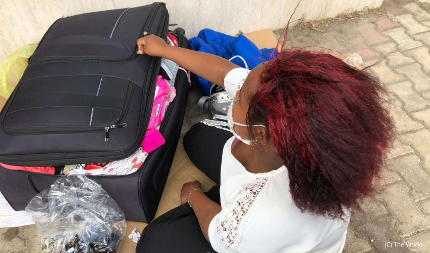 An Ethiopian woman looks through her bags outside the Ethiopian Embassy in Lebanon