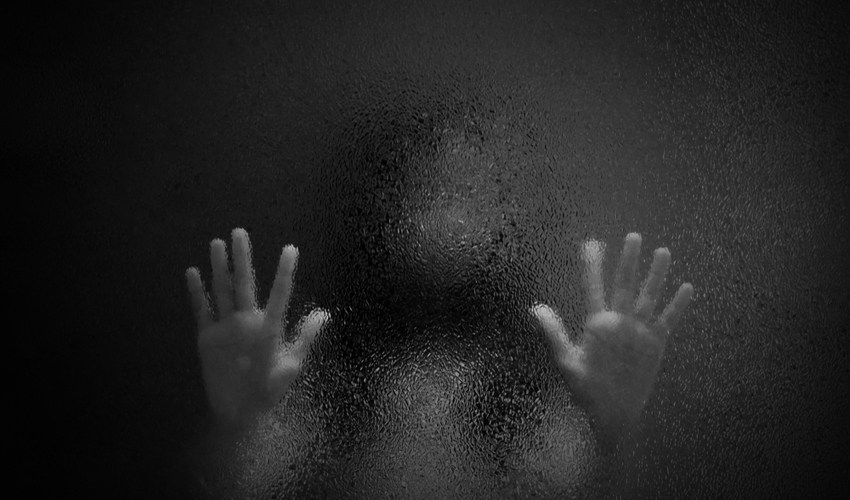 Horror scary shadow of girl behind glass in black and white