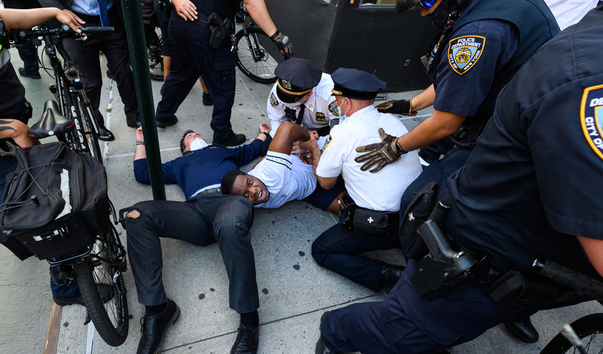 NYPD officers arrest a protester in Union Square during a rally responding to the death of George Floyd