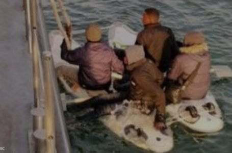 Migrants attempt to cross English Channel on a surfboard, intercepted and returned to France