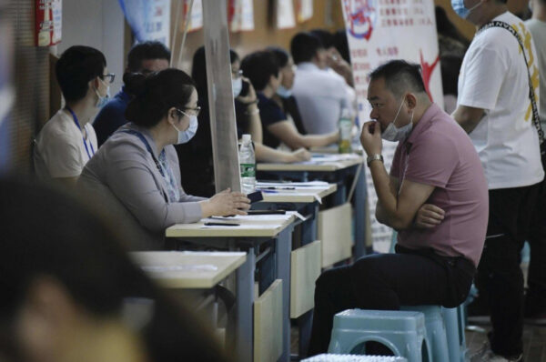 China's unemployment rate drops from last year's pandemic