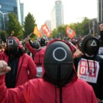 south korean workers wear 'squid game' costumes to protest government